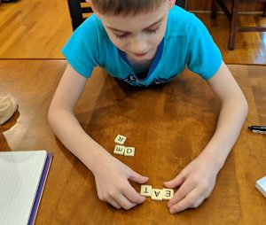 Boy playing scrabble
