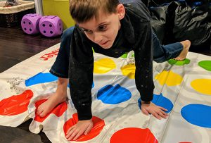 Boy playing Twister