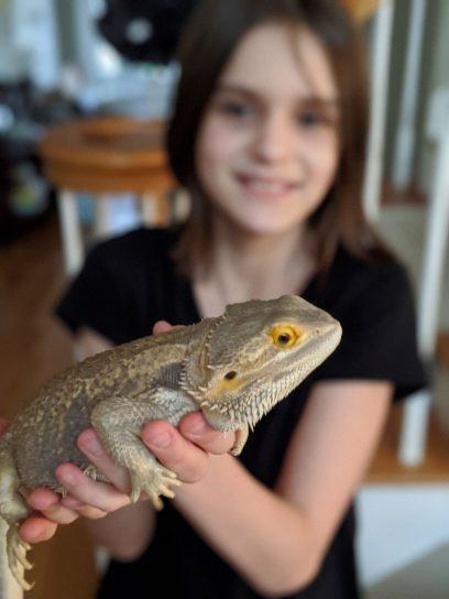 Girl holding bearded dragon