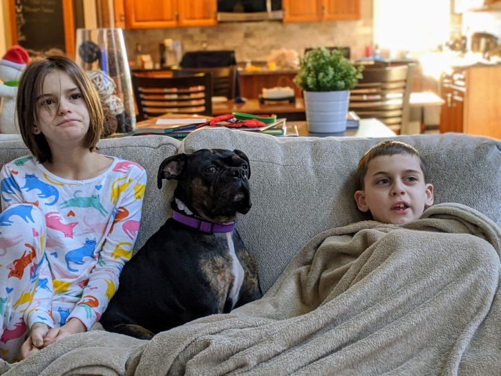 Kids and dog on couch